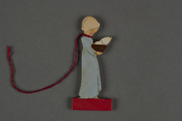 2016.251.4 front Miniature wooden figurine  Click to enlarge