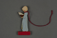 2016.251.4 back Miniature wooden figurine  Click to enlarge