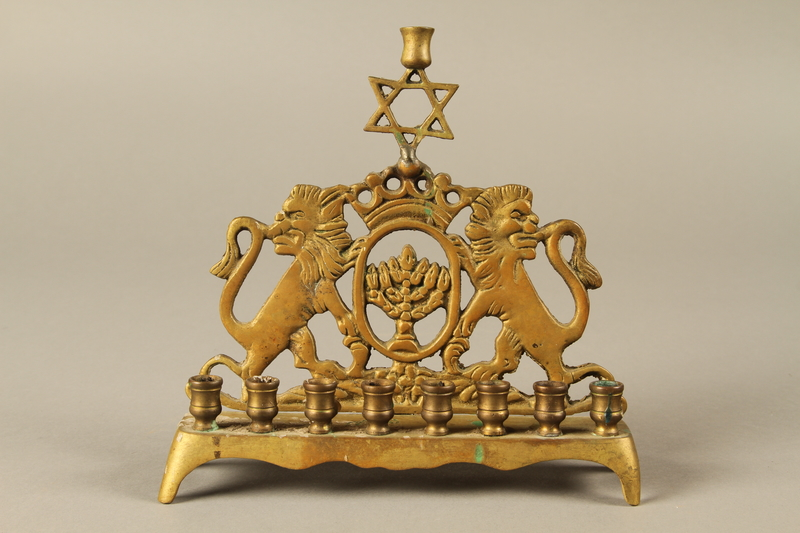 2014.557.2 front Hanukkah menorah with rearing lions used by a Polish German survivor