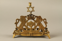2014.557.2 back Hanukkah menorah with rearing lions used by a Polish German survivor  Click to enlarge