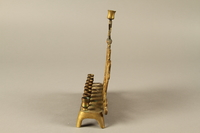 2014.557.2 left Hanukkah menorah with rearing lions used by a Polish German survivor  Click to enlarge
