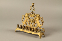 2014.557.2 3/4 view Hanukkah menorah with rearing lions used by a Polish German survivor  Click to enlarge