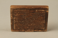 2016.256.1 top Wooden box with a carved lid  Click to enlarge