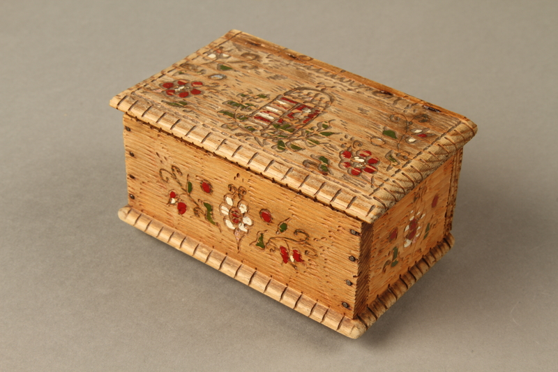 2016.256.2 closed Wooden box with carved and painted floral decorations