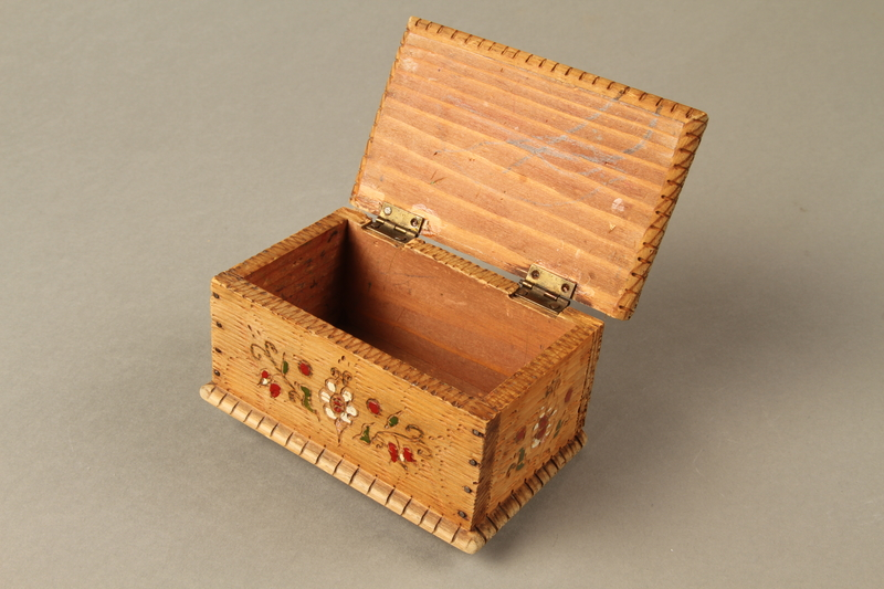 2016.256.2 open Wooden box with carved and painted floral decorations