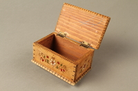 2016.256.2 open Wooden box with carved and painted floral decorations  Click to enlarge