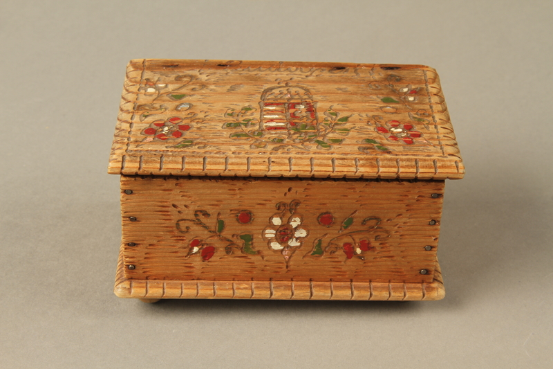 2016.256.2 front Wooden box with carved and painted floral decorations