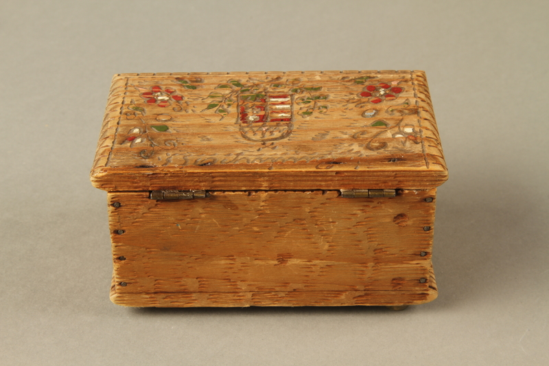 2016.256.2 back Wooden box with carved and painted floral decorations