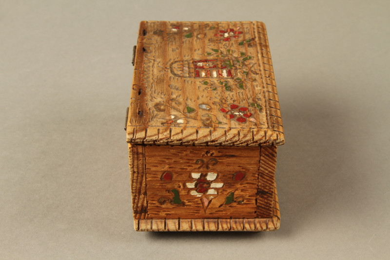2016.256.2 right Wooden box with carved and painted floral decorations