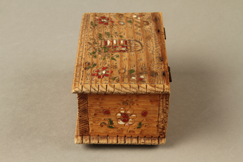 2016.256.2 left Wooden box with carved and painted floral decorations