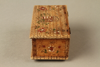 2016.256.2 left Wooden box with carved and painted floral decorations  Click to enlarge