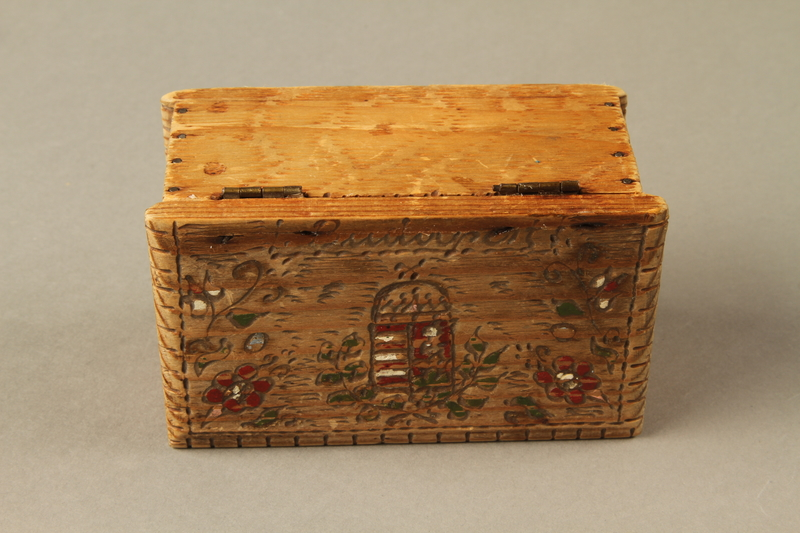 2016.256.2 top Wooden box with carved and painted floral decorations