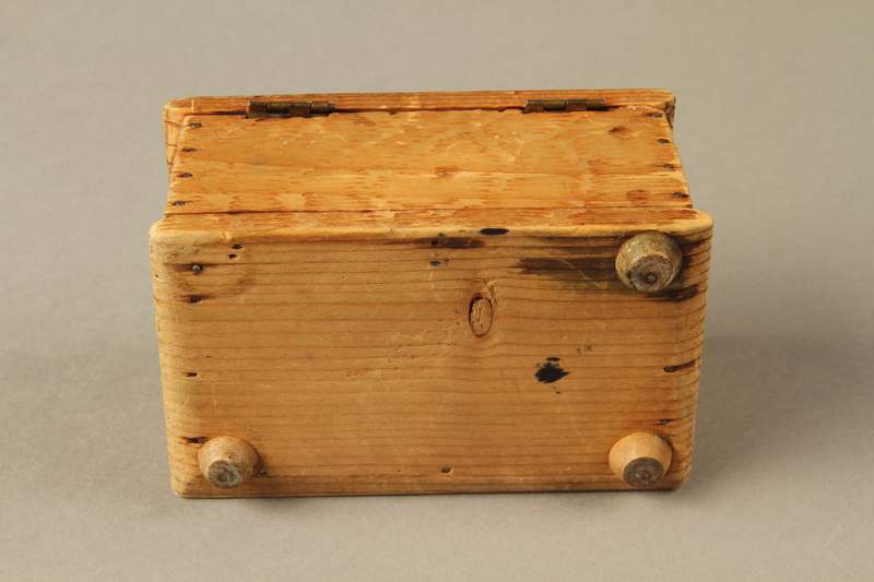 2016.256.2 bottom Wooden box with carved and painted floral decorations