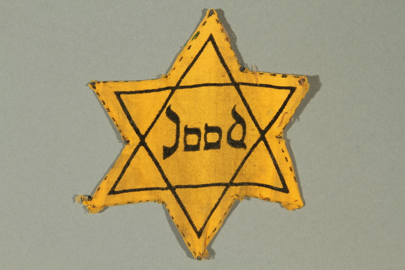 2016.279.2 front Star of David badge printed with Jood worn by a Dutch Jewish girl