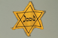 2016.279.2 front Star of David badge printed with Jood worn by a Dutch Jewish girl  Click to enlarge