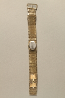 2016.281.2 back Linked band wrist watch worn by Albanian rescuers  Click to enlarge