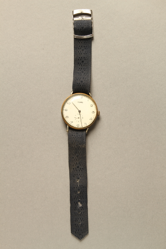 2016.281.3 front Wrist watch with cloth strap worn by Albanian rescuers