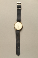2016.281.3 front Wrist watch with cloth strap worn by Albanian rescuers  Click to enlarge