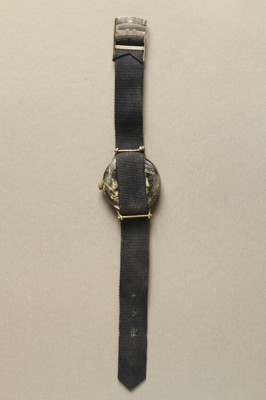 2016.281.3 back Wrist watch with cloth strap worn by Albanian rescuers