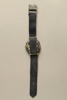 2016.281.3 back Wrist watch with cloth strap worn by Albanian rescuers  Click to enlarge