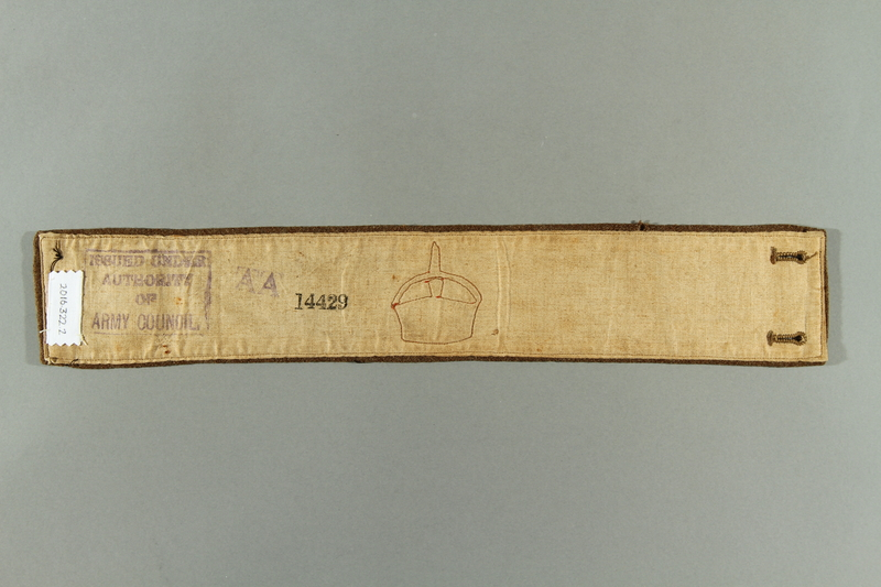 2016.322.2 back British military armband acquired by a Jewish emigre serving in the US Army