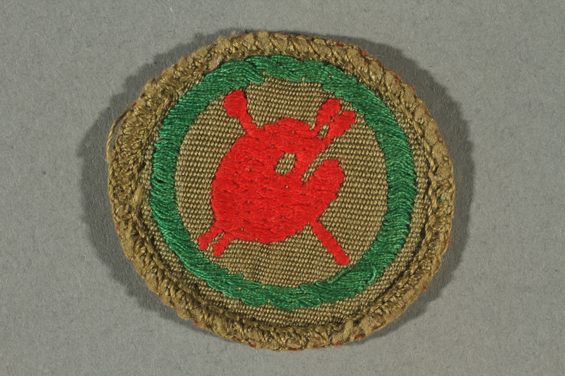 2016.322.3 front Green patch with a paintbrush and palette acquired by a Jewish emigre serving in the US Army