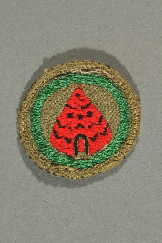 2016.322.4 front Green patch with a red tent acquired by a Jewish emigre in US Army