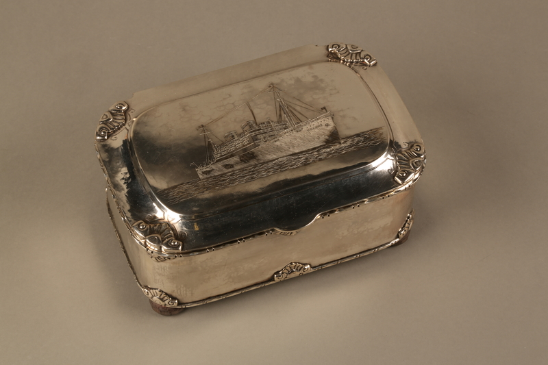 2016.428.1 3/4 view closed Silver box commemorating the launch of the MS St Louis