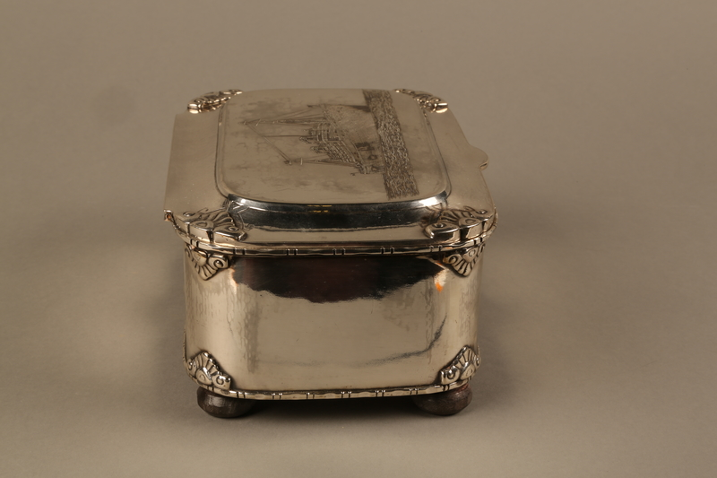 2016.428.1 right side Silver box commemorating the launch of the MS St Louis