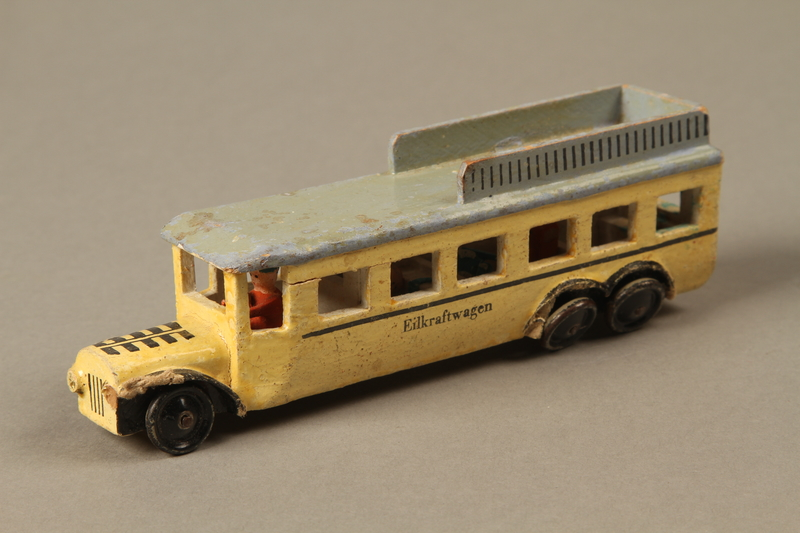2016.220.2_a 3/4 view Wooden toy bus owned by a Czechoslovakian Jewish girl