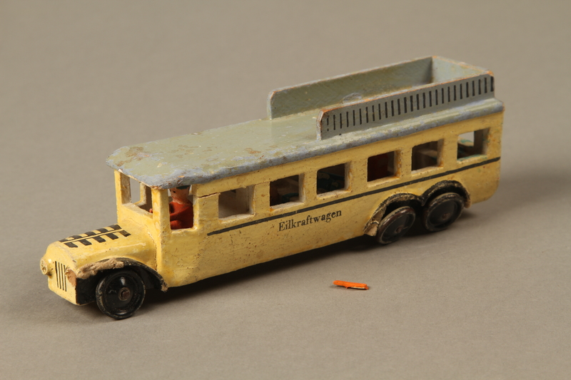 2016.220.2_a-b 3/4 view Wooden toy bus owned by a Czechoslovakian Jewish girl