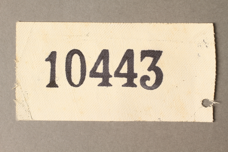 2015.586.6 front Cloth identification patch with prisoner number 10443
