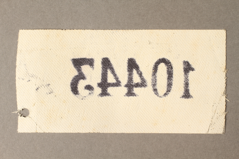 2015.586.6 back Cloth identification patch with prisoner number 10443