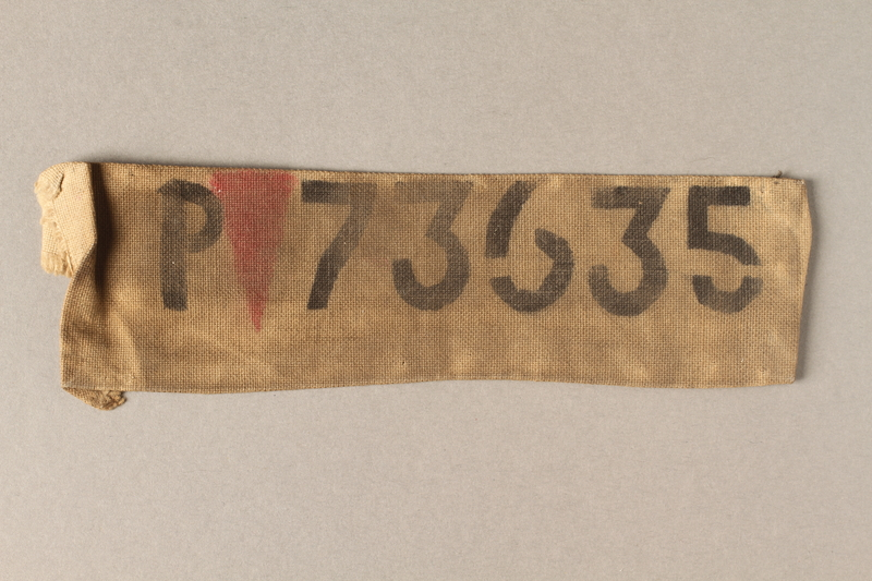 2015.586.7 front Cloth patch with a red triangle and number 73635