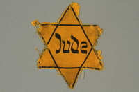 2016.470.1 front Star of David badge printed with Jude  Click to enlarge