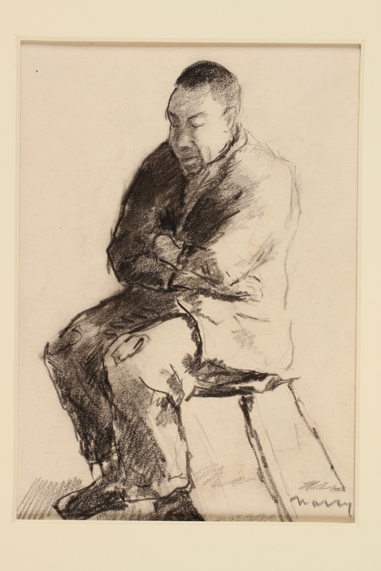 1991.245.3 front Black crayon and pencil drawing of a man seated on a chair with his arms folded across his chest