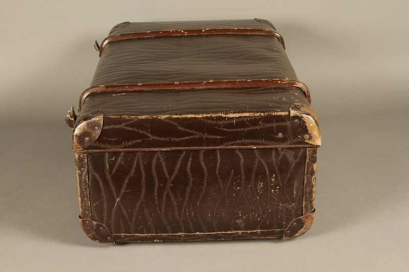 2016.112.8 left Large suitcase with a broken handle used by a young Austrian Jewish refugee during emigration