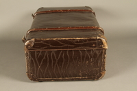 2016.112.8 left Large suitcase with a broken handle used by a young Austrian Jewish refugee during emigration  Click to enlarge