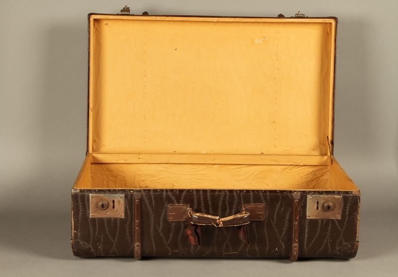 2016.112.8 open Large suitcase with a broken handle used by a young Austrian Jewish refugee during emigration