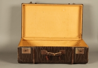 2016.112.8 open Large suitcase with a broken handle used by a young Austrian Jewish refugee during emigration  Click to enlarge