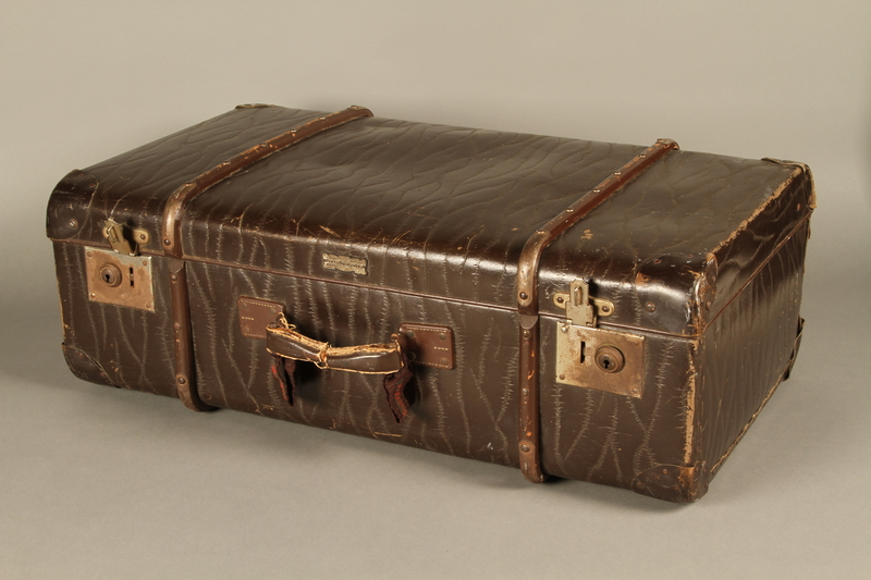2016.112.8 3/4 view Large suitcase with a broken handle used by a young Austrian Jewish refugee during emigration