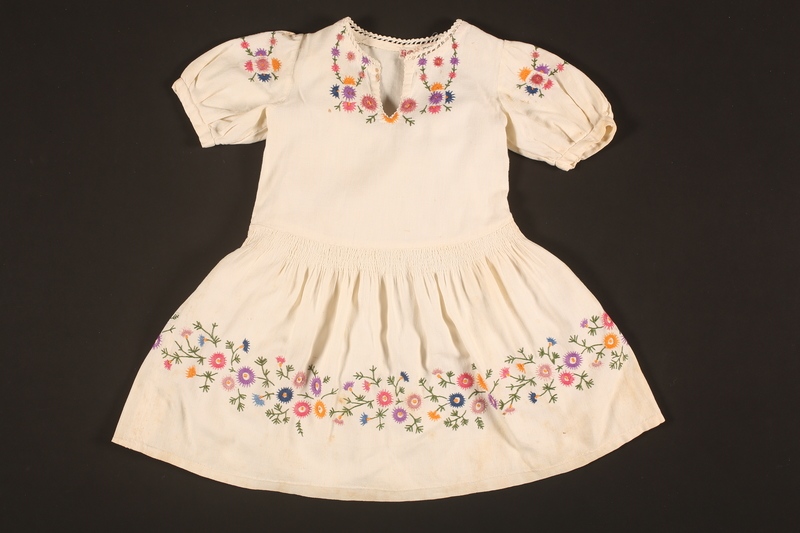 2016.112.9 front Embroidered dress made for a young Austrian Jewish refugee before her emigration