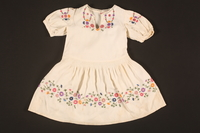 2016.112.9 front Embroidered dress made for a young Austrian Jewish refugee before her emigration  Click to enlarge