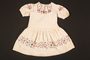 Embroidered dress made for a young Austrian Jewish refugee before her emigration