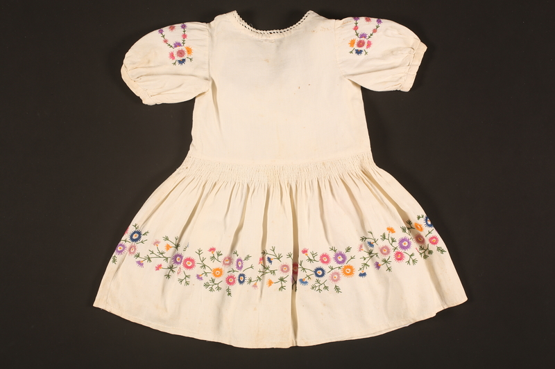 2016.112.9 back Embroidered dress made for a young Austrian Jewish refugee before her emigration