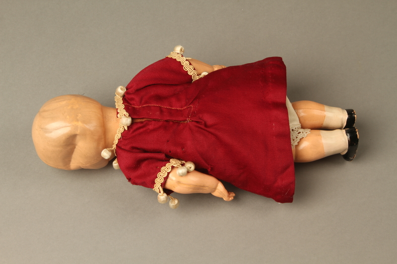 2016.112.10 back Plastic doll with a burgundy dress brought with a young Austrian Jewish refugee