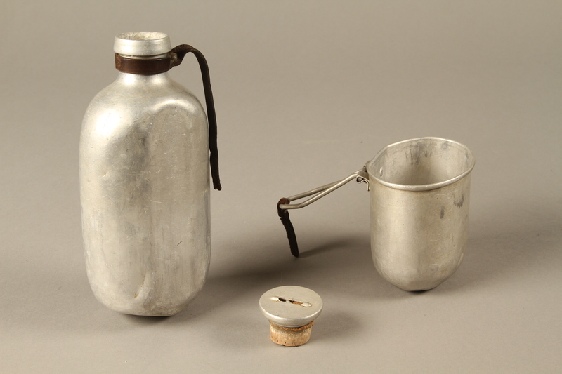 2016.372.5 a-c open Mess kit metal bottle, cork cap, and cup