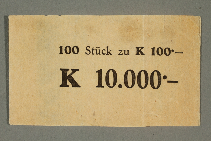 2015.522.8 front Theresienstadt ghetto-labor camp wrapper for 100 kronen note stack issued to a German Jewish inmate