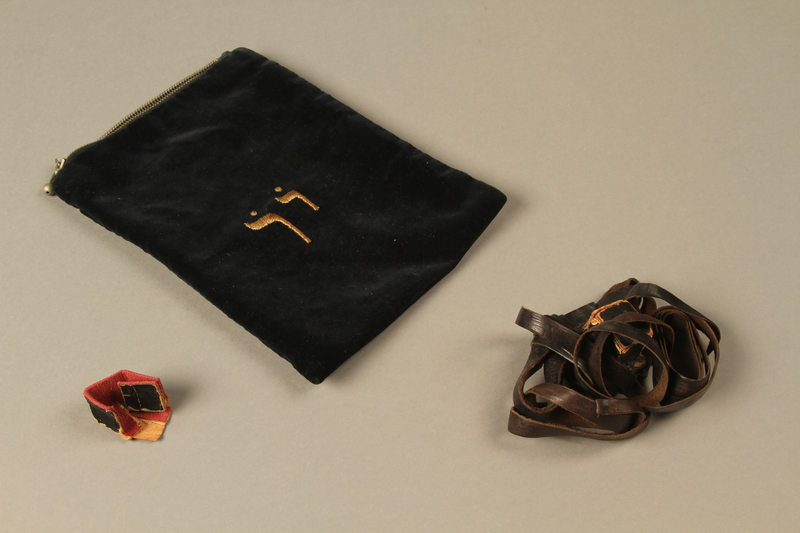 2016.203.15_a-c 3/4 view Single tefillin with covers and pouch owned by a British soldier and Kindertransport refugee