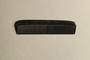 Black plastic comb inside black leather case